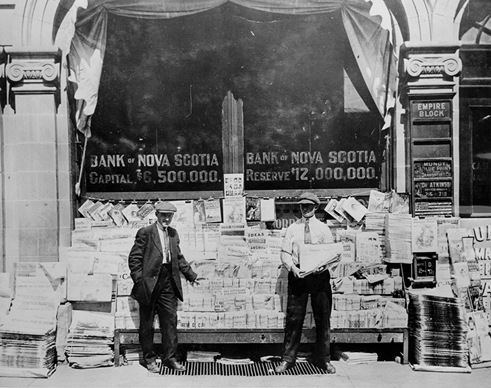 Mike's News Agency, 1908, showing John Michaels and Bob Wright. City of Edmonton Archives, EA-10-1587.