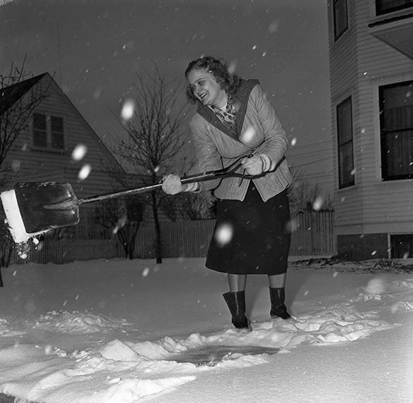First snowfall of year. Alfhild Hansen shovels snow, 1949. City of Edmonton Archives, EA-600-3476c.