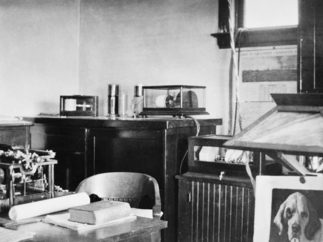 Office of Dominion Meteorologyical Service, Edmonton, Alberta ca. 1915. In home of Eda Owen. Image courtesy of the Glenbow Archives na-4844-38.