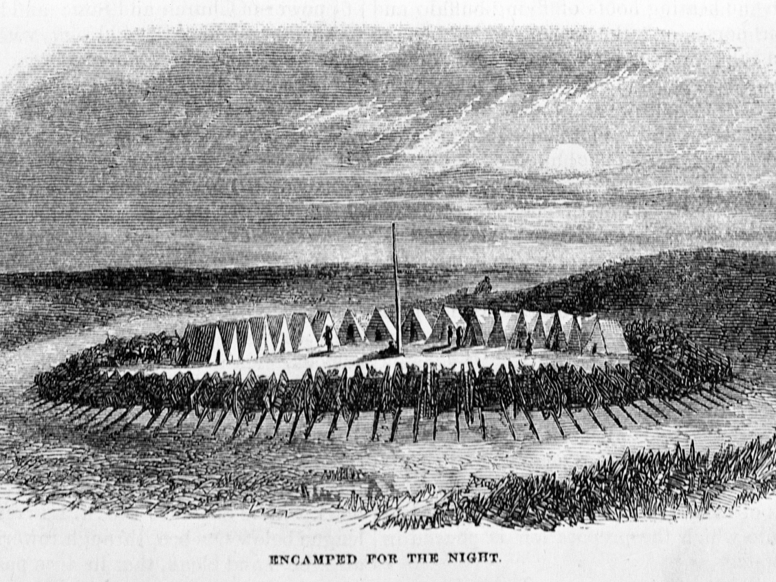 "Metis camp at night, with Red River carts in circle, circa 1859. Published in ""Harper's Monthly"", January 1859, page 175. En route to Red River. Original in Glenbow Library. Image courtesy of the Glenbow Archives na-1406-4."